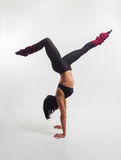 The woman is engaged in gymnastics. Stock Photography