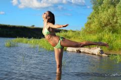 Woman is engaged in yoga Royalty Free Stock Photos