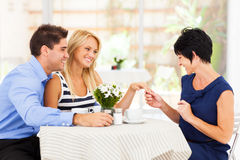 Woman engagement. Happy young women with fiance showing her engagement ring to her mother Stock Images