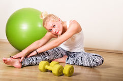 Woman engages in aerobics Stock Photography