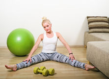 Woman engages in aerobics Royalty Free Stock Images