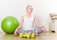 Woman engages in aerobics Stock Images