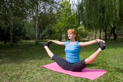 Woman engages in fitness Royalty Free Stock Photo