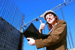 Woman engineer. Female engineer shows that the success of a construction pleased,photography Stock Photo
