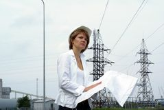Woman engineer or architect safety hat drawings Royalty Free Stock Images