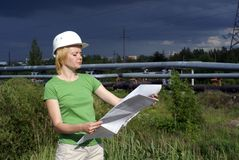 Woman engineer or architect with white safety hat Royalty Free Stock Photo