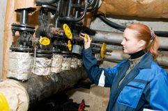 Woman engineer in a boiler room Royalty Free Stock Photos