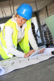 Woman engineer on building site working on the plan Royalty Free Stock Images