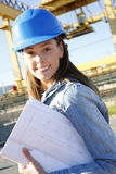 Woman engineer on building site working Royalty Free Stock Image