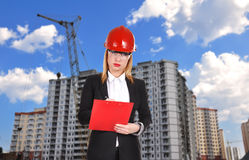 Woman engineer with clipboard Royalty Free Stock Image