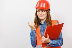 Woman engineer construction builder in helmet. Royalty Free Stock Photography