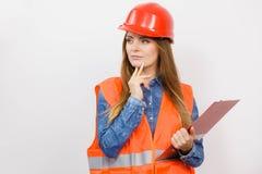 Woman engineer construction builder in helmet. Royalty Free Stock Image