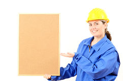 Woman engineer cork board in hand Royalty Free Stock Photo