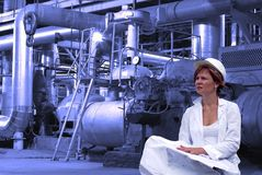 Woman engineer, equipment, cables and piping Royalty Free Stock Photos