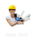 Woman engineer with hardhat. A pretty young woman engineer carrying construction drawings and wearing a yellow hardhat. Copy space available Royalty Free Stock Photography