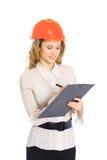 A woman engineer in helmet Royalty Free Stock Photos