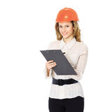 Woman engineer in a helmet with a folder in his hands Royalty Free Stock Photos