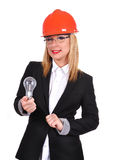 Woman engineer holding bulb Stock Images
