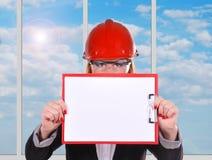 Woman engineer holding clipboard Stock Photo