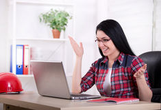 Woman engineer looking at laptop in the office Stock Photos