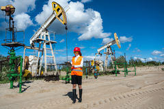 Woman engineer in the oilfield Stock Image