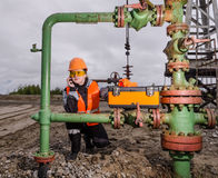 Woman engineer in the oilfield Royalty Free Stock Image