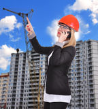 Woman engineer with phone Royalty Free Stock Photo