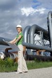 Woman engineer with safety hat, drawings Stock Photography