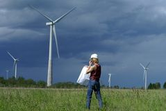 Woman engineer safety hat wind turbines Royalty Free Stock Photography