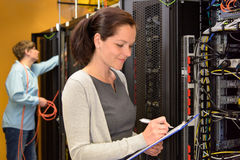 Woman IT engineer in server room Royalty Free Stock Image