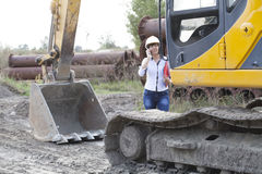 Woman engineer on site telephone call Royalty Free Stock Images