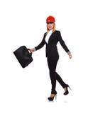 Woman engineer walking Stock Images