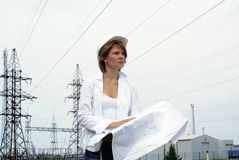Woman engineer with white safety hat drawings Royalty Free Stock Photo