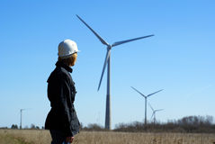 Woman engineer and wind turbines stock photos