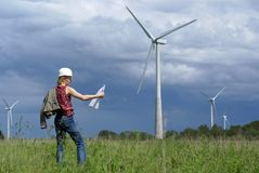 Woman engineer and wind turbines Royalty Free Stock Image