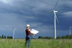 Woman engineer and wind turbines Royalty Free Stock Photos
