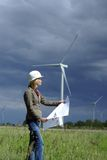Woman engineer and wind turbines Stock Photo