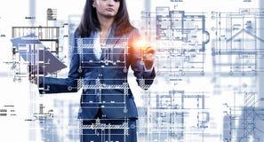 Woman engineer at work . Mixed media Royalty Free Stock Photo