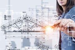 Woman engineer at work . Mixed media Stock Photo