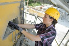 Woman engineer working on building site stock images