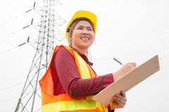 Woman Engineering working on High-voltage tower Royalty Free Stock Photo