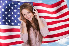 Woman English Language Audiobook. Woman Listening English Language Learning Course Audiobook In Front Of American Flag Stock Photos