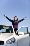 Woman enjoing her new car Stock Images