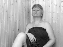 Woman in Sauna. Woman is enjoing and relaxing in a Sauna Royalty Free Stock Photography