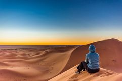 Free Woman Enjoing Sunrise In The Sahara Desert Next To M`hamid In Mo Stock Photo - 126563390