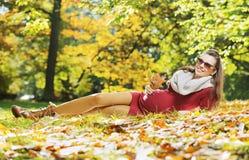Woman enjouing the golden autumn Stock Photos