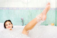Woman enjoy bath foam in the bathtub Royalty Free Stock Images