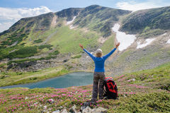 Woman enjoy beautiful view in the mountains Stock Photo