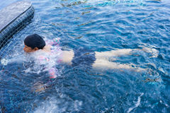 Woman enjoy blue pool water. Colorful swimming dress woman enjoy and relax in swimming pool clear blue water stock images