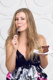 Woman enjoy cake Stock Images